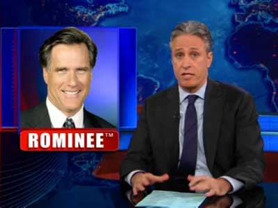 Jon Stewart Mocks Romney for Cave on Employing Gay Spokesman