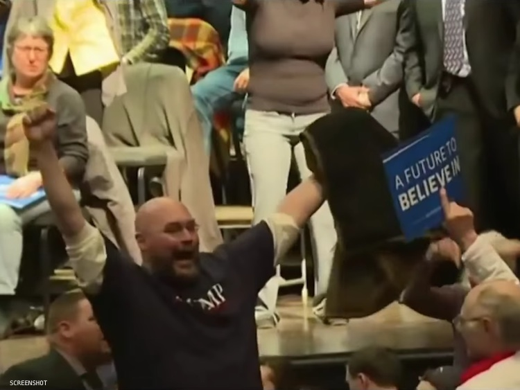 A Trump supporter is removed from a Bernie Sanders rally