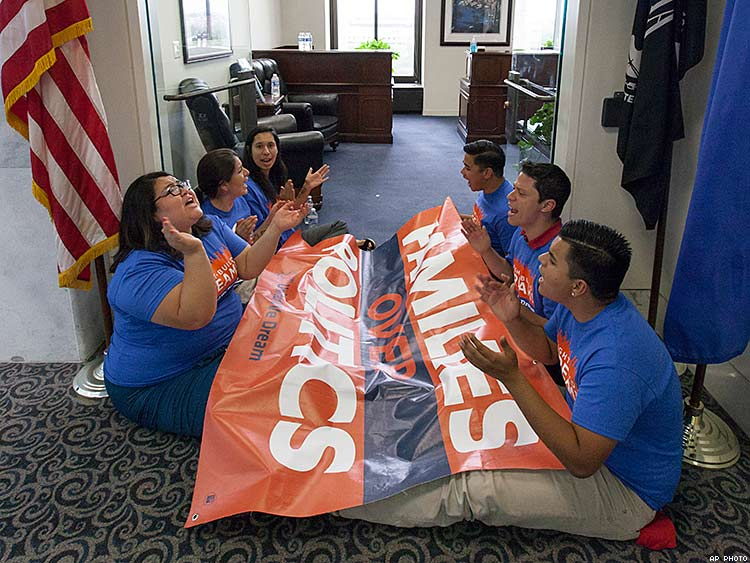 Protesters stage a sit-in at the state office of Senate Majority Leader Harry Reid in Washington in September of 2014.