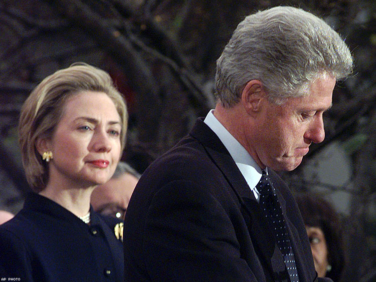First lady Hillary Clinton watches President Clinton pause as he thanks those Democratic members of the House of Representatives who voted against impeachment in 1998.