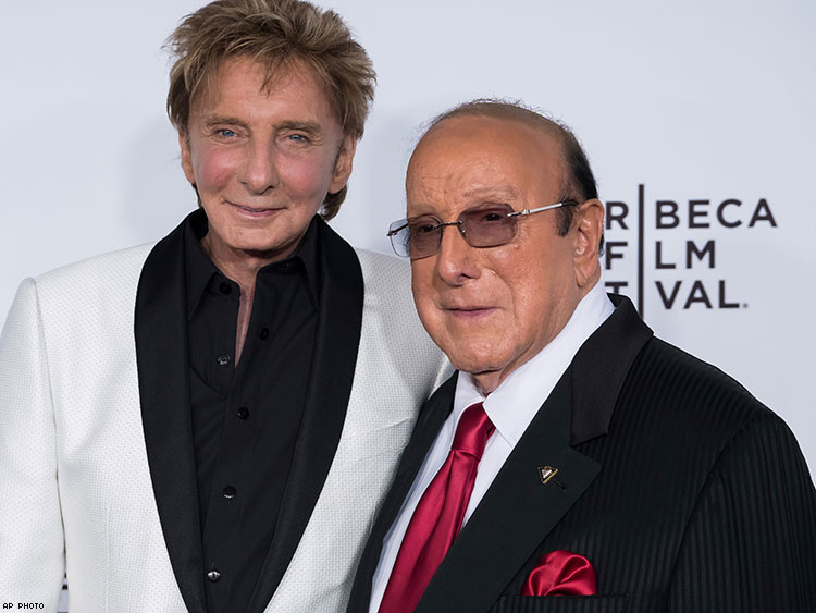 Barry Manilow celebrates with Clive Davis.