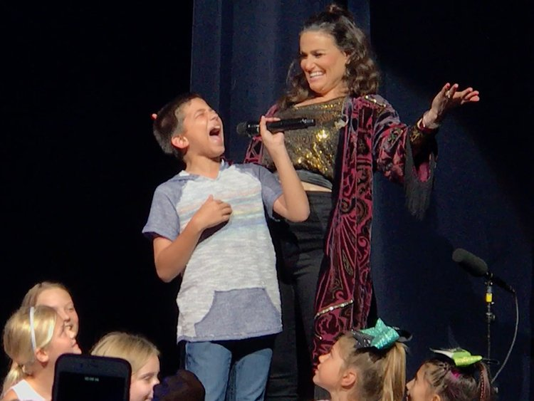 Boy, 11, steals the show at Idina Menzel concert