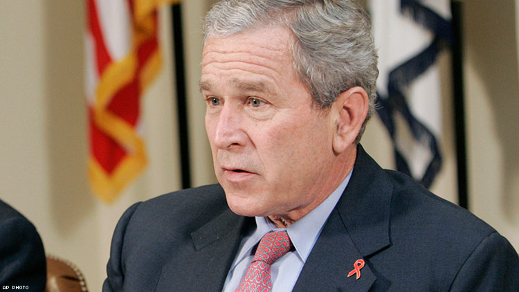 President Bush wearing his HIV/AIDS awareness pin on World AIDS Day in 2006.