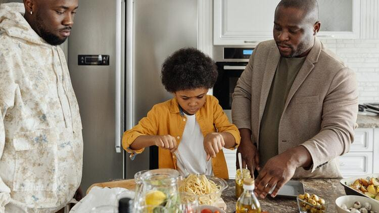 Fathers and son making dinner