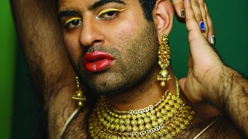 Photo of genderqueer Indian-American artist Alok Vaid-Menon in a gold slip dress