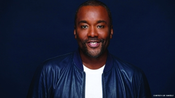 Lee Daniels in black jacket and white T-shirt