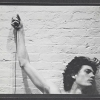 Identical self-portraits of Robert Mapplethorpe with trip cable in hand, 1974