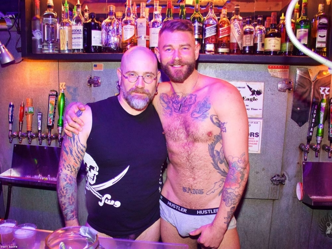 Three gays bound guy in bar in working time