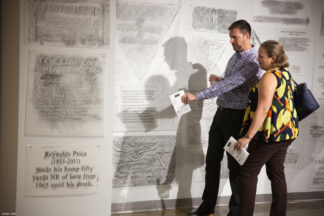 Kerry Clawson and Jessica Robinson investigate rubbings from around the world that are part of the exhibition The Gay Rub currently on display at Univeristy of South Florida's Center Gallery.
