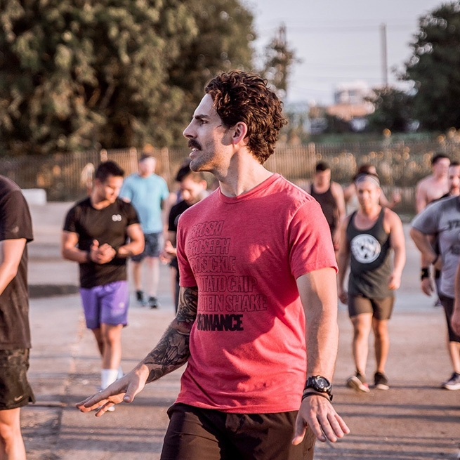 Will Lanier instructing LGBTQ athletes participating in a recent OUTWOD event.