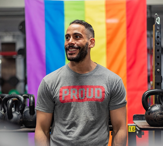 """Todd Brandon Morris, founder of OUT-FIT, and coach at CrossFit NYC, wearing his company's """"Proud"""" t-shirt."""