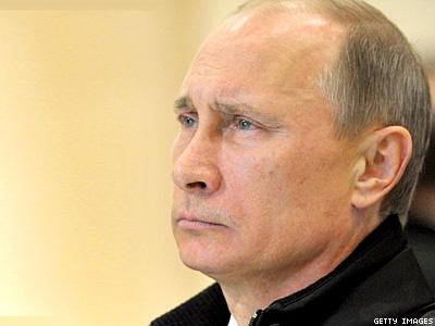 Putin Signs Adoption Ban for Gay Foreign Couples