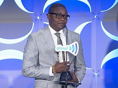 WATCH: Ugandan Trans Man Emotionally Accepts GLAAD Award
