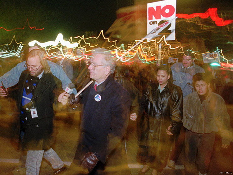Former Colorado Governor Roy Romer marches with LGBT people protesting the passage of Amendment 2 in 1992