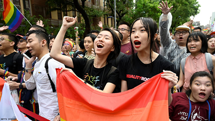 Supporters of same-sex marriage celebrate outside the parliament in Taipei on May 17, 2019.