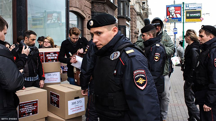 Russian policemen surround Russian gay rights activists in Moscow in 2017.