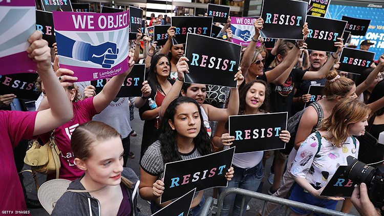 Dozens of protesters gather in Times Square near a military recruitment center to show their anger at President Donald Trump's decision to reinstate a ban on transgender individuals from serving in the military