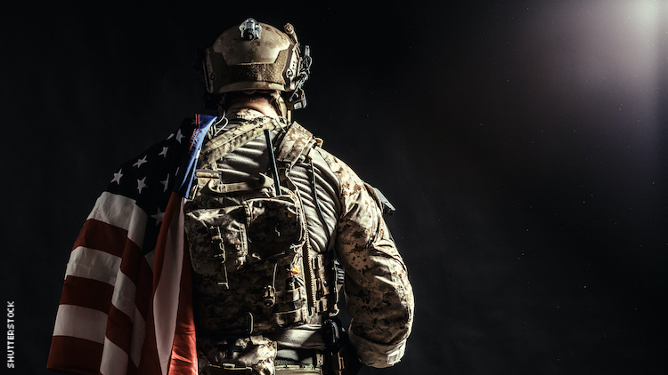 Man in the army with American flag over shoulder