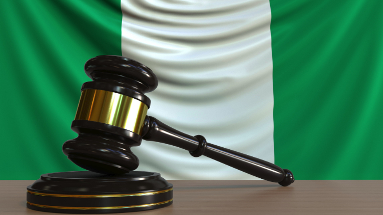 gavel in front of Nigerian flag