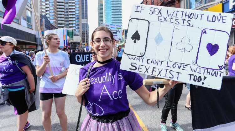 An asexual person at Pride