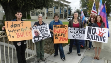 WATCH: Activists Picket Calif. Group Targeting Trans Kids