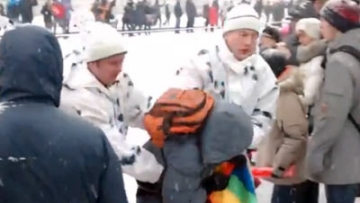 WATCH: Russian Activist Detained for Unfurling Rainbow Flag