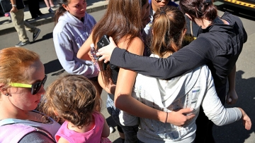 Students and family members gather after a gunman opened fire at Oregon's Umpqua Community College Thursday
