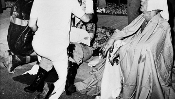 Firemen give first aid to survivors of a French Quarter fire that swept through a second story bar leaving 29 dead and 15 injured, June 25, 1973, in New Orleans. Several persons leaped to safety before the entire bar was engulfed in flames.