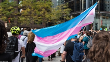 A transgender flag is woven