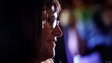 A side profile of Christine Hallquist, who stands to the left. She is wearing glasses.