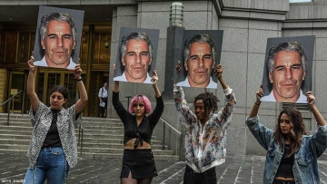 "A protest group called ""Hot Mess"" hold up signs of Jeffrey Epstein in front of the Federal courthouse on July 8 2019."
