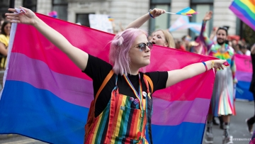 person with bisexual flag
