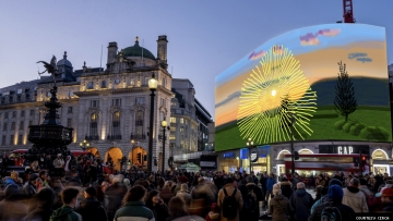 David Hockney's artwork Don't Stare at The Sun... on a big screen in London's Piccadilly Circus