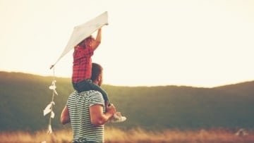 Parent and child with kite