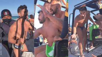 two men being arrested on a Mexican beach while a crowd gathers