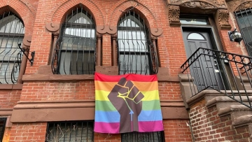 Apartment with Pride banner