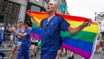 Medical worker with Pride flag