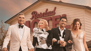 The Schitt's Creek cast in front of the Rosebud Motel