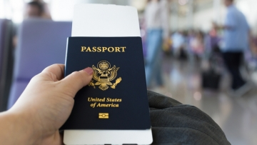 A person holding a passport