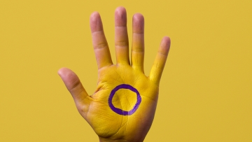 Hand with intersex flag on it