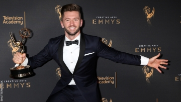 Travis Wall with an Emmy