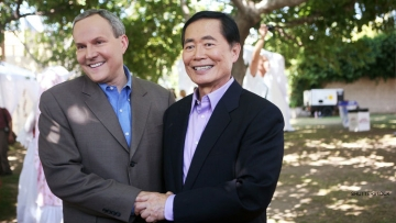 [Photo: George Takei stands with his husband as they get a marriage license.]