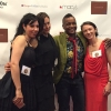 Lesbian poetry award winner Dawn Lundy Martin sports a dapper suit while flanked by friends and fellow nominees.
