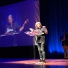 Writer Eileen Myles reads a poem to the audience after receiving the Pioneer Award.