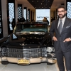 Eneuri Acosta poses with a Cadillac