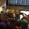 Police pepper spray the crowd at Seattle–Tacoma International Airport