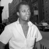 Author James Baldwin, shown on a Harlem street in New York City, June 3, 1963