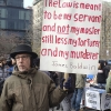January 19, 2015: Several hundred activists gathered at Union Square Park prior to starting the Four Mile March on Martin Luther King's birthday. An activist holds a sign quoting James Baldwin.