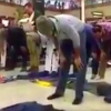 Protesters form a circle around men in prayer at  Denver International Airport