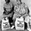 Two women with bags of food at the People's Free Food Program